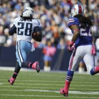 Photo -   Tennessee Titans running back Chris Johnson (28) runs for a touchdown against Buffalo Bills' Stephon Gilmore (27) during the first half of an NFL football game in Orchard Park, N.Y., Sunday, Oct. 21, 2012. (AP Photo/Gary Wiepert)