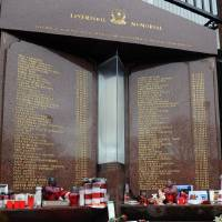 Photo - Tributes are laid at the memorial of the Hillsborough disaster outside Anfield before the English Premier League soccer match between Liverpool and Manchester City at Anfield in Liverpool, England, Sunday, April 13, 2014. (AP Photo/Clint Hughes)