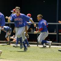 Photo - Binger-Oney's Cord Coffey celebrates with the rest of the team after scoring the winning run against Roff in the Class A state baseball championship at Dolese Park in Warr Acres, Okla., Saturday, May 10, 2014. Photo by Bryan Terry, The Oklahoman