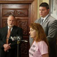 Photo - A former pharmacist's supporter, Karen Monahan, talks to reporters Wednesday while his new attorney Doug Friesen, left, and state Sen. Ralph Shortey listen.  DOUG HOKE - THE OKLAHOMAN