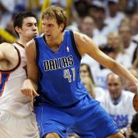 Photo - Dallas' Dirk Nowitzki (41) works the ball against Oklahoma City's Nick Collison (4) during Game 2 of the first round in the NBA basketball  playoffs between the Oklahoma City Thunder and the Dallas Mavericks at Chesapeake Energy Arena in Oklahoma City, Monday, April 30, 2012.  Oklahoma City won, 102-99. Photo by Nate Billings, The Oklahoman