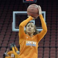 Photo - Tennessee's Meighan Simmons shoots during practice at the NCAA college basketball tournament in Louisville, Ky., Saturday, March 29, 2014. Tennessee plays Maryland in a regional semifinal on Sunday.  (AP Photo/Timothy D. Easley)