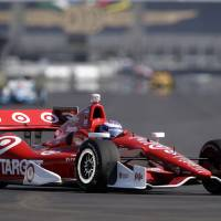 Photo - Scott Dixon, of New Zealand, drives through the turn 7 during practice for the inaugural Grand Prix of Indianapolis IndyCar auto race at the Indianapolis Motor Speedway in Indianapolis, Thursday, May 8, 2014. (AP Photo/Michael Conroy)