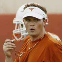 Photo - COLLEGE FOOTBALL: University of Texas running backs coach Major Applewhite is shown during a team workout Thursday, Aug. 7, 2008, in Austin. Texas. Although not the quarterbacks coach, Applewhite is often questioned about tutoring Longhorns quarterback Colt McCoy. Texas is set to host Rice Saturday.  (AP Photo/Harry Cabluck) ORG XMIT: AT103
