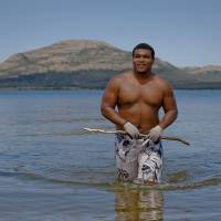 Photo - SUPER 30 / HIGH SCHOOL FOOTBALL PLAYER: Lawton High School's true country boy Ivan Thomas walks out of Lake Lawtonka after doing some noodling on Tuesday, June 18, 2013 in Lawton, Okla.   Photo by Chris Landsberger, The Oklahoman
