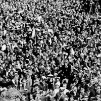 Photo - FILE - In this June 26, 1963 file photo, U.S. President John F. Kennedy, left, waves to a crowd of more than 300,000 gathered to hear his speech where he declared