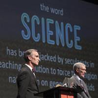 Photo - Creation Museum head Ken Ham, right, speaks during a debate on evolution with TV's