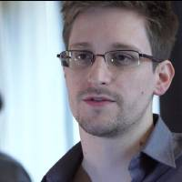 Photo - This photo provided by The Guardian Newspaper in London shows Edward Snowden, who worked as a contract employee at the National Security Agency, June 9, 2013, in Hong Kong. U.S. intelligence officials are planning an electronic monitoring system that would tap into government, financial and public databases to scan the behavior patterns of many of the 5 million government employees who hold secret clearances, according to current and former officials. The system draws on a Defense Department model in development for more than a decade, documents reviewed by the Associated Press show. (AP Photo/The Guardian, Glenn Greenwald and Laura Poitras)
