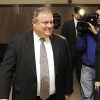 Photo - POLITICAL BRIBERY CASE / CORRUPTION HEARING: Secretary of State Glenn Coffee, a former president pro tem of the Senate, leaving the courtroom after testifying at the preliminary hearing for Rep. Randy Terrill, R-Moore, and former state Sen. Debbe Leftwich at the Oklahoma County Courthouse in Oklahoma City, Wednesday, Nov. 2, 2011.   Terrill is accused of offering Leftwich a bribe, an $80,000-a-year state job, to not run last year for re-election. Photo by Paul B. Southerland, The Oklahoman ORG XMIT: KOD