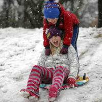 Photo - Turner and Ryan, front, Kinzer sled at Hafer Park in Edmond, Okla., Tuesday, Feb. 13, 2013.Photo by Sarah Phipps, The Oklahoman