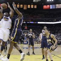 Photo - Golden State Warriors' Carl Landry (7) shoots next to Indiana Pacers' Ian Mahinmi, second from left, during the first half of an NBA basketball game in Oakland, Calif., Saturday, Dec. 1, 2012. (AP Photo/Marcio Jose Sanchez)