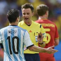 Photo - Referee Nicola Rizzoli of Italy speaks with Argentina's Lionel Messi during the World Cup quarterfinal soccer match between Argentina and Belgium at the Estadio Nacional in Brasilia, Brazil, Saturday, July 5, 2014. (AP Photo/Martin Meissner)
