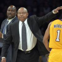Photo -   Los Angeles Lakers interim head coach Bernie Bickerstaff, center, pats guard Darius Morris on the head as assistant coach Chuck Person looks on during the first half of their NBA basketball game against the Golden State Warriors, Friday, Nov. 9, 2012, in Los Angeles. (AP Photo/Mark J. Terrill)