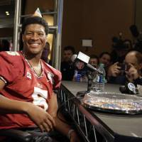 Photo - Florida State's Jameis Winston wears a birthday hat as he answers a question during media day for the NCAA BCS National Championship college football game Saturday, Jan. 4, 2014, in Newport Beach, Calif. Florida State plays Auburn on Monday, Jan. 6, 2014. Winston's birthday is Jan. 6. (AP Photo/David J. Phillip)