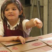 Photo -  Phoebe Russell, then 6 years old, had a goal to help out the hungry in her community. Little did she know it would spark quite the response. (Photo courtesy Tyson Foods)