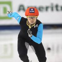 Photo - Jessica Smith competes in the women's 1,000 meters during the U.S. Olympic short track speedskating trials on Sunday, Jan. 5, 2014, in Kearns, Utah. (AP Photo/Rick Bowmer)