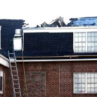 Photo - Attic and roof damage were caused by a fire at the Alpha Gamma Delta Sorority house in Norman.  Photo by Steve Sisney, The Oklahoman  STEVE SISNEY - THE OKLAHOMAN