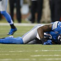 Photo -   Detroit Lions wide receiver Calvin Johnson (81) lays on the turf after being injured during the second half against the Minnesota Vikings at Ford Field in Detroit, Sunday, Sept. 30, 2012. (AP Photo/Rick Osentoski)