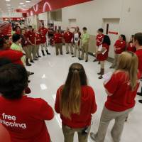<p>Target employees in Norman get last-minute instructions before opening the doors last Thanksgiving Day. [Photo by Steve Sisney, The Oklahoman Archives]</p>