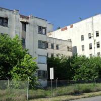Photo - The six-story former Mercy hospital stood boarded up and dilpaidated at NW 13 and Walker for a quarter century before it was cleared by the city to make way for a new housing development.  PAUL B. SOUTHERLAND