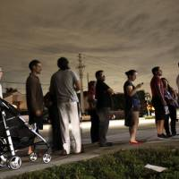 Photo -   FILE - This Nov. 6, 2012 file photo shows voters lined up in the dark to beat the 7:00 p.m. deadline to cast their ballots at a polling station in Miami. It's not just the economy. It's the demographics _ the changing face of America. The 2012 elections drove home trends that have been embedded in the fine print of birth and death rates, immigration statistics and census charts for years. America is rapidly getting more diverse. And, more gradually, so is its electorate. Non-whites made up 28 percent of the electorate this year, up from 21 percent in 2000, and much of that growth is coming from Hispanics. (AP Photo/Wilfredo Lee, File)