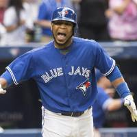 Photo - Toronto Blue Jays Edwin Encarnacion celebrates after hitting a walk-off three-run home run against the Milwaukee Brewers during the ninth inning of a baseball game, Wednesday, July 2, 2014 in Toronto. (AP Photo/The Canadian Press, Chris Young)
