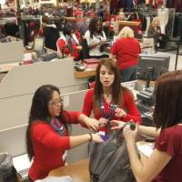 Photo - Items are rung up at the register as shoppers turn out for early Black Friday shopping at the Kohl's store in Midwest City, OK, Friday, November 23, 2012, By Paul Hellstern, The Oklahoman