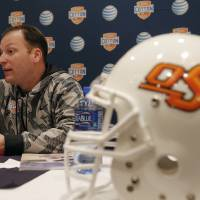 Photo - OSU offensive coordinator Mike Yurcich had an up-and-down first season. AP photo