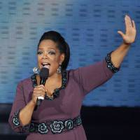 Photo -   FILE - In this May 17, 2011 file photo, Oprah Winfrey acknowledges fans during a star-studded double-taping of