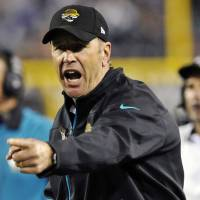Photo -   Jacksonville Jaguars head coach Mike Mularkey contests a touchdown by the Indianapolis Colts during the first half of an NFL football game, Thursday, Nov. 8, 2012, in Jacksonville, Fla. (AP Photo/Stephen Morton)