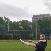 Photo - In this undated image from internet video, Havard Rugland, of Norway, kicks a ball in a series of trick shots in Norway. Rugland hasn't played a single game at any level of football. Still, he's pursuing a long-shot bid to make the NFL thanks to a YouTube video showing him kicking field goals from almost any angle or distance. (AP Photo/YouTube)