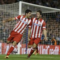 Photo - Atletico's Diego Costa, left celebrates with  Koke after he scored a penalty during the Champions League semifinal second leg soccer match between Chelsea and Atletico Madrid at Stamford Bridge Stadium in London Wednesday, April 30, 2014. (AP Photo/Kirsty Wigglesworth)