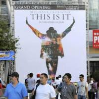 "Photo -  Michael  Jackson fans arrive to buy tickets for the "" Michael  Jackson's This Is It"" film, at L.A. Live in Los Angeles, Thursday, Sept. 24, 2009. Tickets for the advance screening will go on sale Sunday, Sept. 27, 2009. The film was produced from hundreds of hours of backstage footage of rehearsals last June. (AP Photo/Jae C. Hong)"