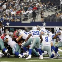 Photo - Dallas Cowboys quarterback Tony Romo (9) takes a knee in a victory formation against the Tampa Bay Buccaneers during the finals seconds of an NFL football game on Sunday, Sept. 23, 2012, in Arlington, Texas. The Cowboys won 16-10. (AP Photo/LM Otero)