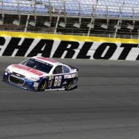 Photo - Dale Earnhardt Jr.  drives his car out of Turn 4 during NASCAR Sprint Cup auto race testing for the 2014 season at Charlotte Motor Speedway in Concord, N.C., Wednesday, Dec. 11, 2013. (AP Photo/Chuck Burton)