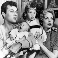Photo - Tony  Curtis  and Janet Leigh are shown with their daughters Kelly, 2 1/2, and newborn Jamie Lee in Hollywood, Ca., in this Jan. 16, 1959 file photo.  Curtis  died Wednesday Sept. 29, 2010 at his Las Vegas area home of a cardiac arrest at 85 according to the Clark County, Nev. coroner. (AP Photo, File)