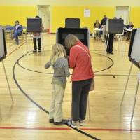 Photo -   Voters cast their vote at El Dorado Community School in El Dorado at Santa Fe, N,M, Tuesday morning, Nov., 2012. After a grinding presidential campaign, Americans are heading into polling places across the country. (AP Photo/The Santa Fe New Mexican, Clyde Mueller)
