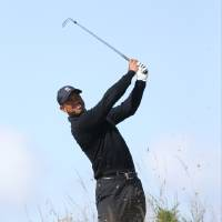 Photo - Tiger Woods of the US plays a shot on the 15th hole during a practice round ahead of the British Open Golf championship at the Royal Liverpool golf club, Hoylake, England, Tuesday July 15, 2014. The British Open starts on Thursday July 17. (AP Photo/Peter Morrison)