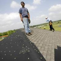 Roofers, other repair crews in Oklahoma City seek dry summer days