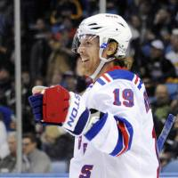 Photo - New York Rangers center Brad Richards celebrates his second of three goals against the Buffalo Sabres during the second period of an NHL hockey game in Buffalo, N.Y., Friday, April 19, 2013. New York won 8-4. (AP Photo/Gary Wiepert)