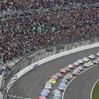Photo - Drivers take the green flag to start a NASCAR Sprint Cup race at Kansas Speedway in Kansas City, Kan., Sunday, April 21, 2013. (AP Photo/Colin E. Braley)