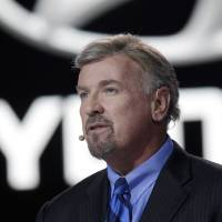 Photo - Hyundai President and CEO David Zuchowski, discusses the automaker's Genesis vehicle at the North American International Auto Show in Detroit, Monday, Jan. 13, 2014. (AP Photo/Carlos Osorio)