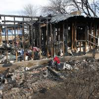 Photo - Oklahoma Natural Gas workers were investigating a leak for about an hour on Jan. 3 before an explosion destroyed this home at 9208 S Villa in Oklahoma City. The home was still a pile of burned lumber and scorched metal Friday. Photo by David McDaniel, The Oklahoman?  David McDaniel - The Oklahoman
