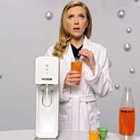 "Photo - This undated frame grab provided by SodaStream, shows the company's 2014 Super Bowl commercial. SodaStream's ad features ""Her"" actress Scarlett Johansson promoting its at-home soda maker and will run in the fourth quarter. The ad, which promotes the product as a healthier and less wasteful way to make soda, made waves ahead of the game when the company said it would delete it's last line, ""Sorry, Coke and Pepsi,"" at a request by Fox. (AP Photo/SodaStream)"