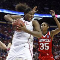 Photo - Courtney Paris pulls in a rebound in front of Angel McCoughtry in the first half as the University of Oklahoma plays Louisville at the 2009 NCAA women's college basketball tournament Final Four in the Scottrade Center in Saint Louis, Missouri on Sunday, April 5, 2009.   Photo by Steve Sisney, The Oklahoman ORG XMIT: KOD