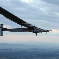 Photo - German test pilot Markus Scherdel steers the solar-powered Solar Impulse 2 aircraft for its maiden flight at its base in Payerne, Switzerland Monday,  June 2, 2014. The aircraft is the second solar plane of the Solar Impulse project. The main goal of the project is to circumnavigate the world with an aircraft, powered only by solar energy.  (AP Photo/Denis Balibouse,Pool)