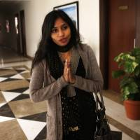 Photo - Devyani Khobragade, who served as India's deputy consul general in New York, greets journalists as she leaves Maharastra state house in New Delhi, India, Saturday, Jan. 11, 2014. Khobragade, 39, is accused of exploiting her Indian-born housekeeper and nanny, allegedly having her work more than 100 hours a week for low pay and lying about it on a visa form. Khobragade has maintained her innocence, and Indian officials have described her treatment as barbaric. (AP Photo/Saurabh Das)