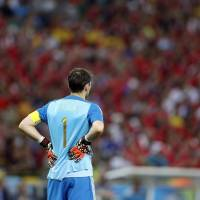 Photo - Spain's goalkeeper Iker Casillas stands near his goal mouth in the final minutes of the group B World Cup soccer match between Spain and Chile at the Maracana Stadium in Rio de Janeiro, Brazil, Wednesday, June 18, 2014. Defending champion Spain was eliminated from the World Cup after losing to Chile 2-0. (AP Photo/Frank Augstein)
