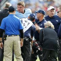 Photo - Tennessee Titans tackle David Stewart is helped onto a cart after breaking his right leg in the first quarter of an NFL football game against the Houston Texans, Sunday, Dec. 2, 2012, in Nashville, Tenn. (AP Photo/Joe Howell)