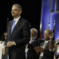 Photo -   Attorney General Eric Holder is welcomed at the NAACP annual convention Tuesday, July 10, 2012, in Houston. Holder says he opposes a new photo ID requirement in Texas elections because it would be harmful to minority voters. (AP Photo/Pat Sullivan)